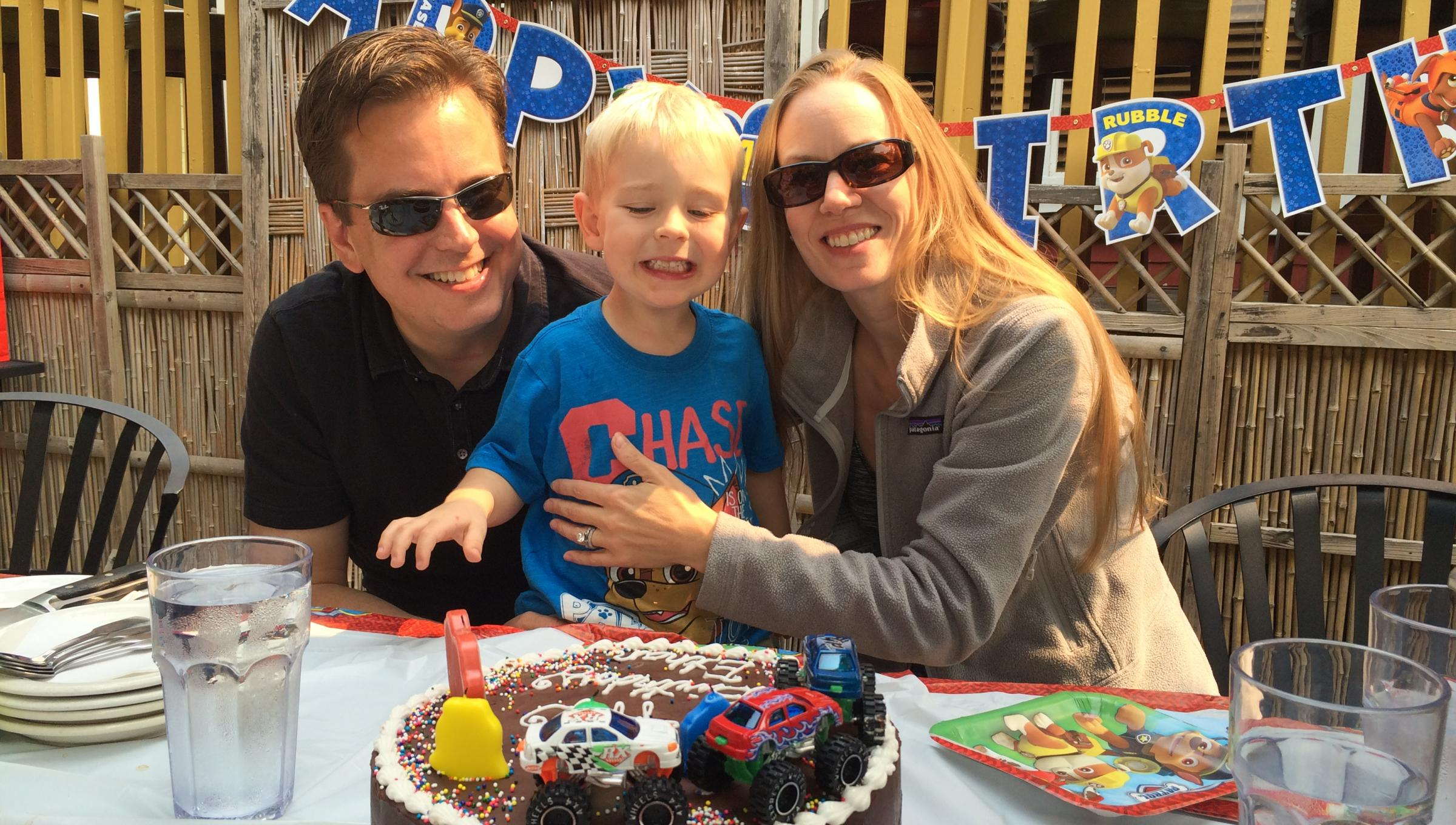 Lacey Siekas with her son and husband celebrating her son's birthday