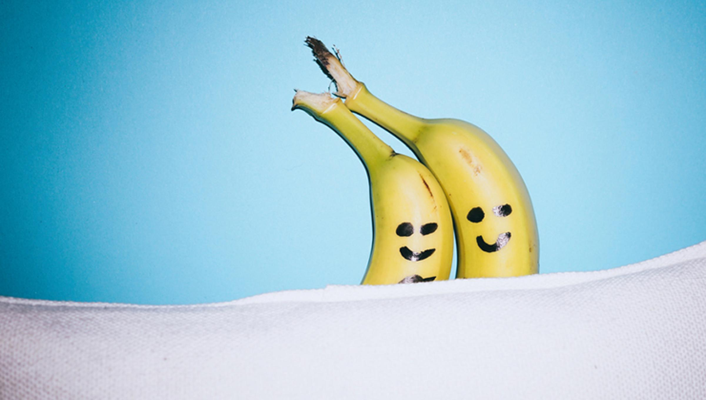 happy banana couple in bed