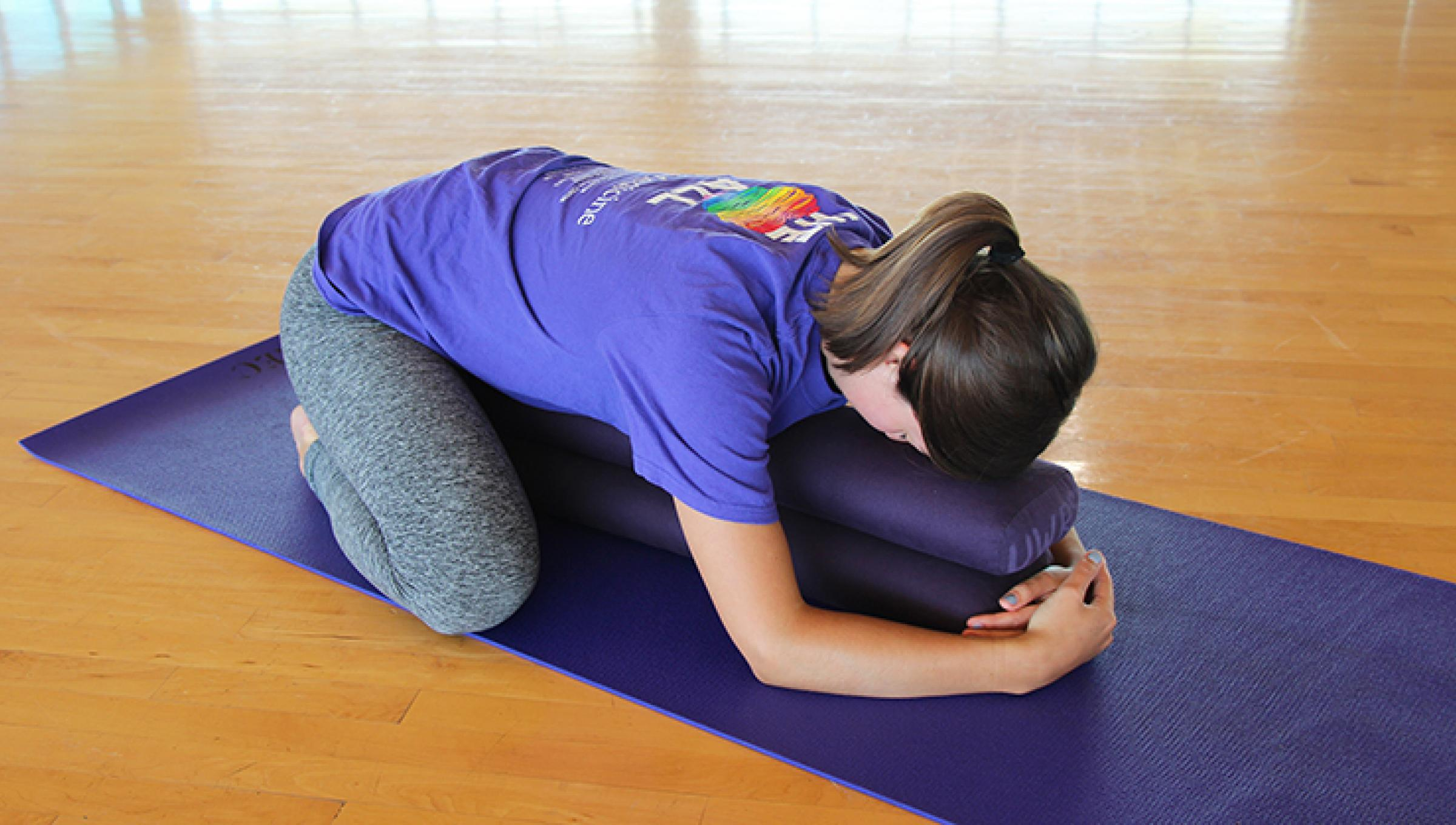 woman doing the yoga pose called child's pose