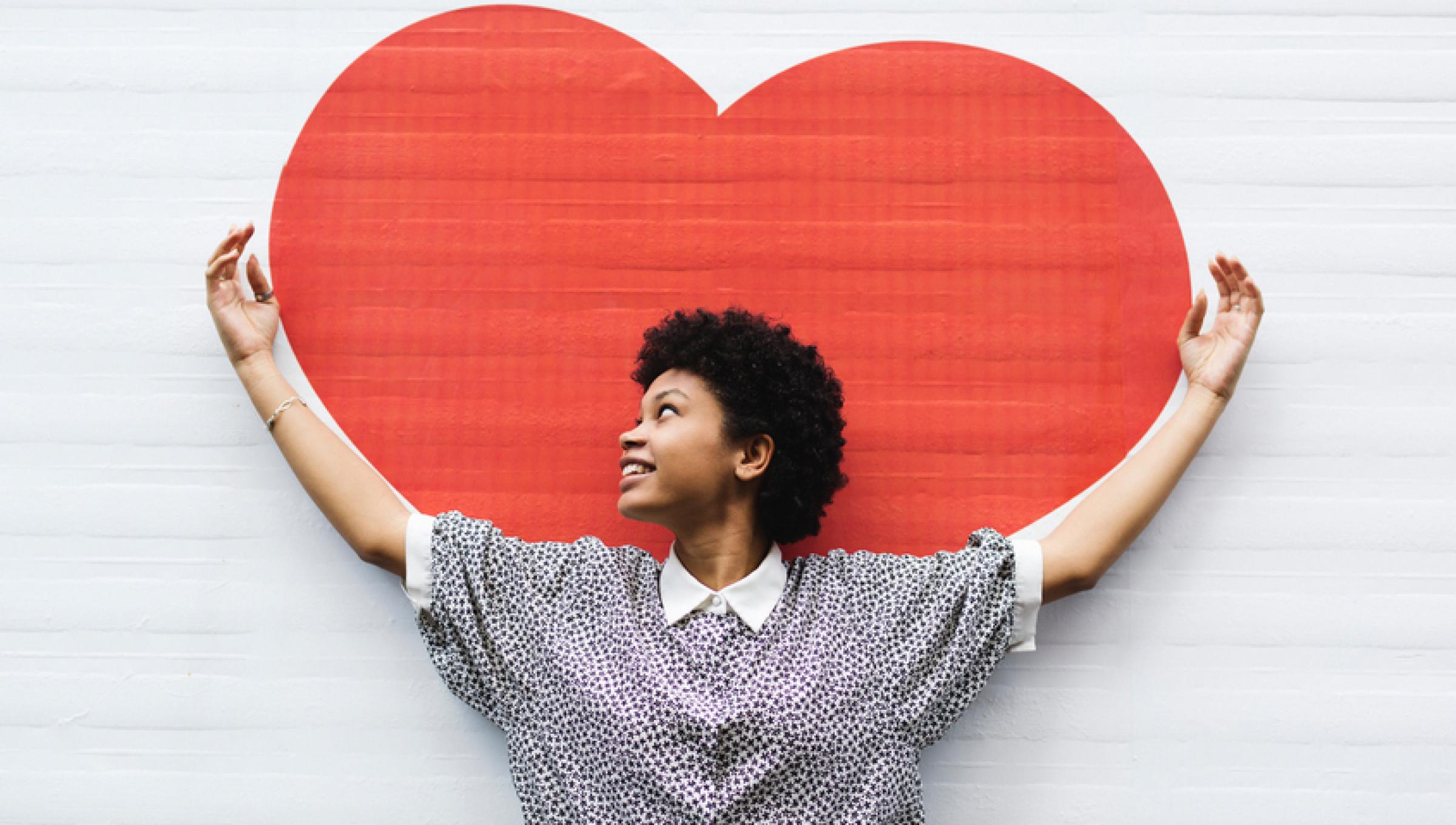 Woman in front of painted heart