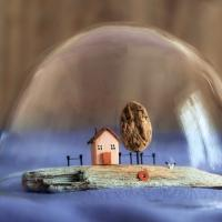 Miniature house in a bubble