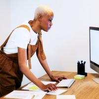 woman-standing-at-computer