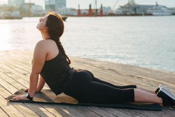 Woman stretching on dock