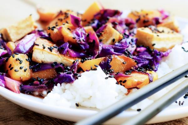 A meal of rice, purple cabbage, sweet potatoes and tofu.