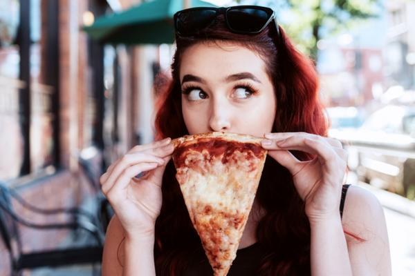 woman-holding-pizza