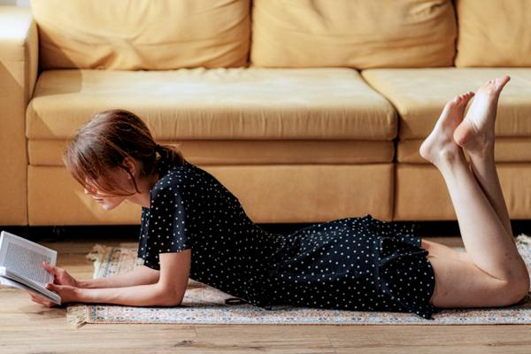 woman reading a book on the floor