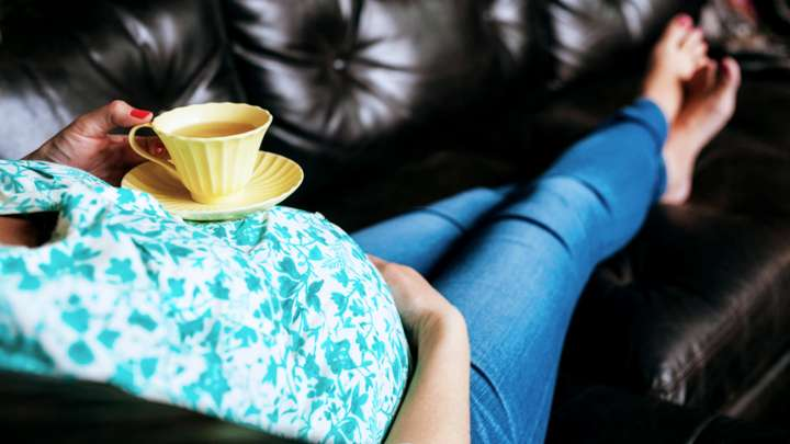 pregnant-woman-holding-teacup