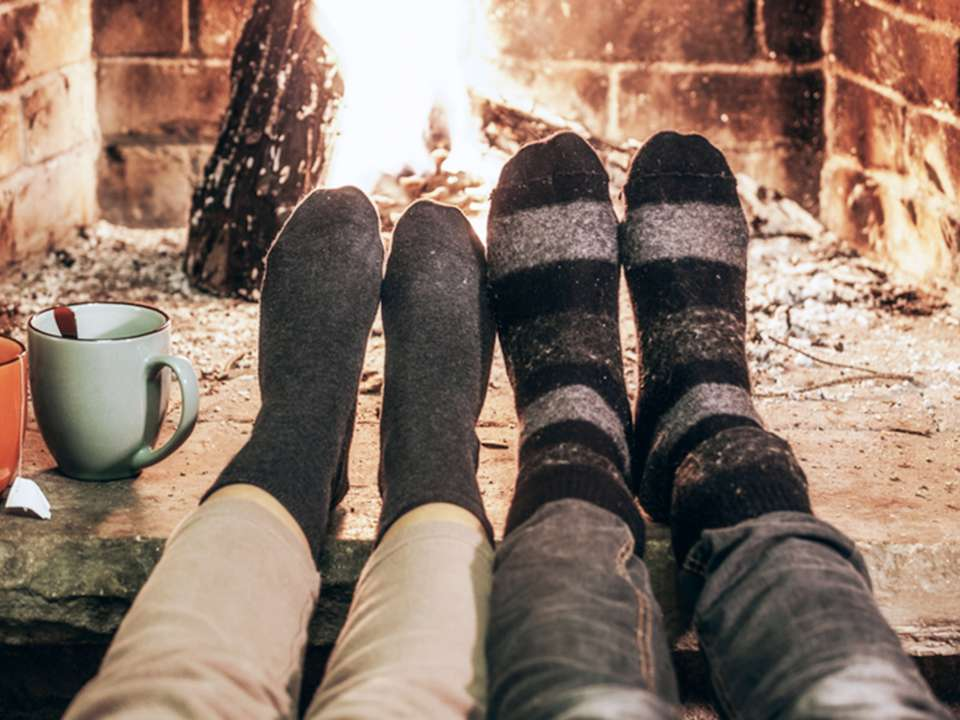 feet-resting-by-fireplace