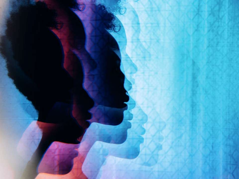 A prismatic image of the silhouette of a woman's head.