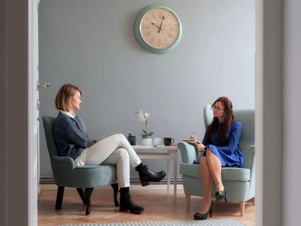 A therapist speaks with a client.