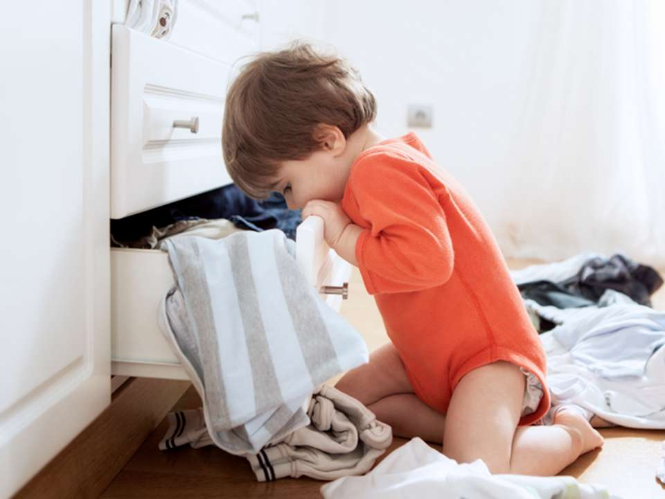 child looking into drawer